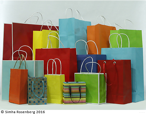 Colorful shopping bags illustrate Public Voice NY's nonprofit marketing packages.