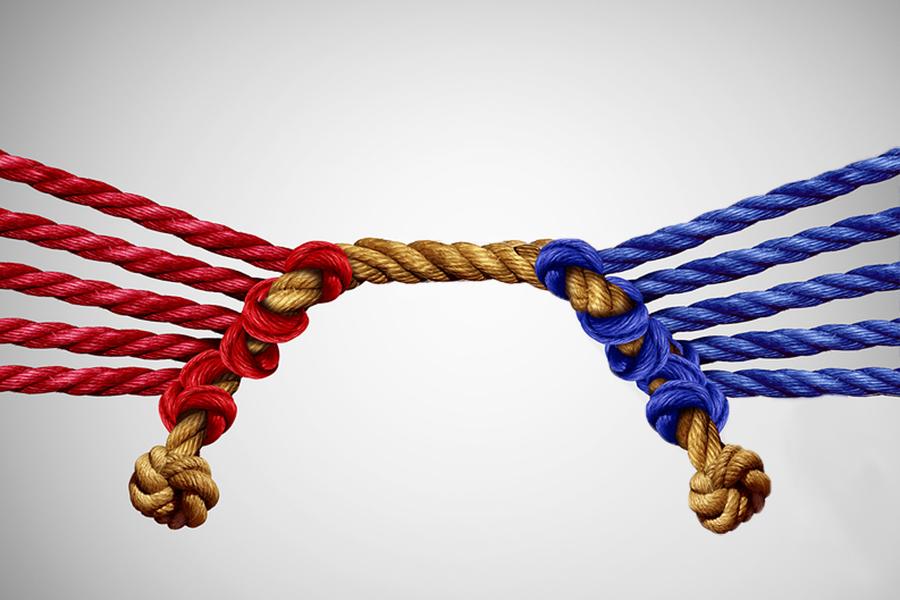 Image of red vs blue tug of war illustrates nonprofit narratives for personae non gratae