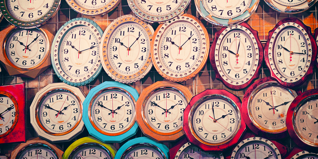 Colorful photo of many different wall clock on the wall illustrates the nonprofit time allocation tool.