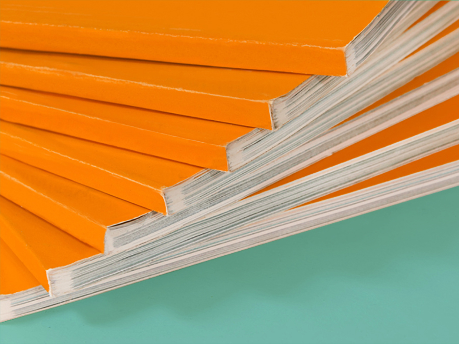 Stack of colorful annual reports