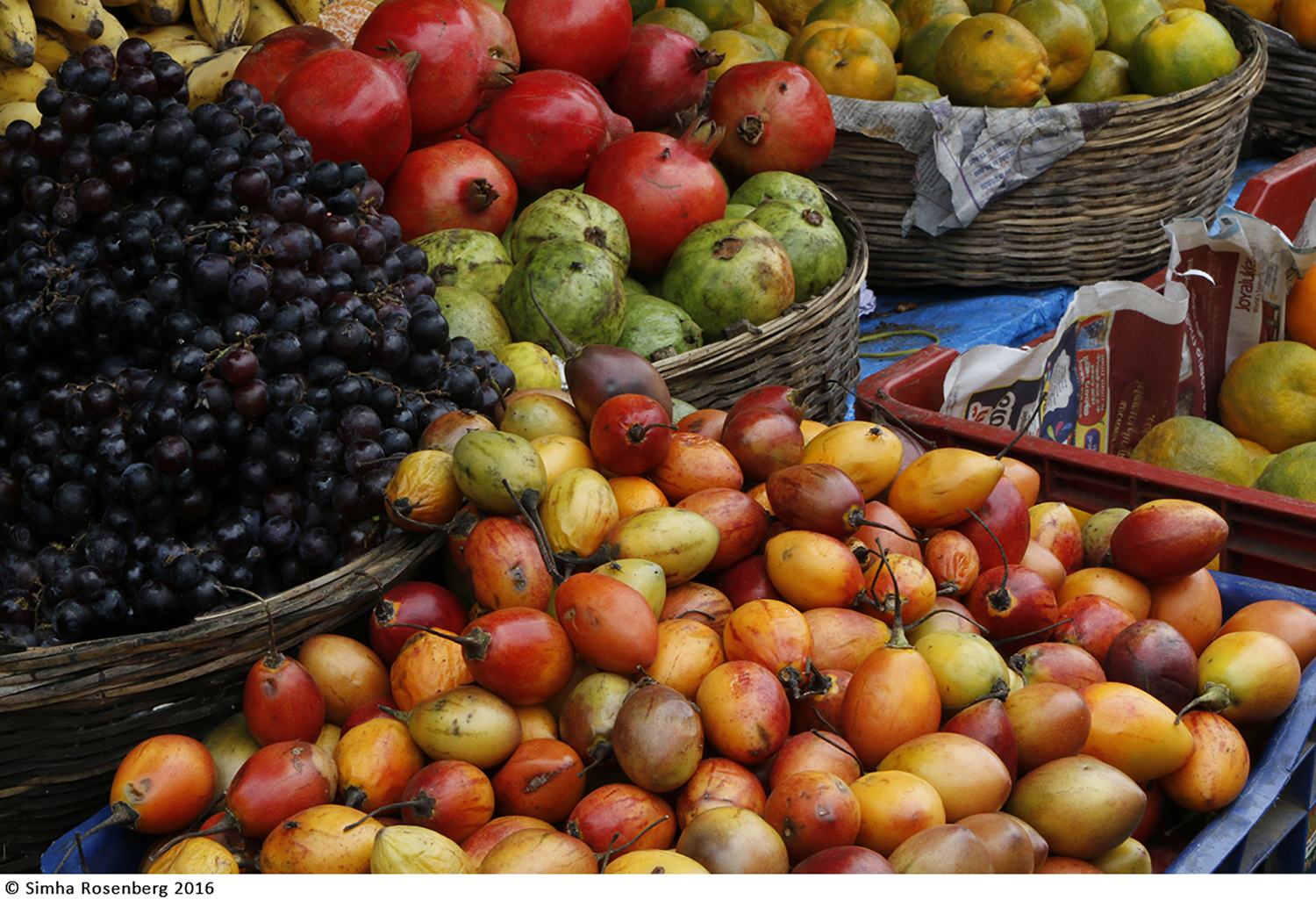 An image of lush fruit at a market is a metaphor for the impact of producing fresh nonprofit content.