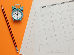 Blank calendar, pencil, and clock illustrate nonprofit editorial calendars..