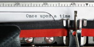 Closeup of old fashioned typewriter with the words once upon a time on the paper depicts nonprofit storytelling tool.