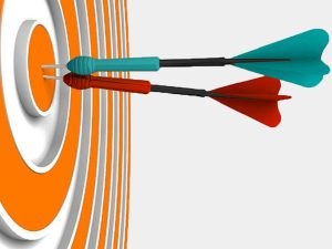 Colorful darts hitting the bullseye illustrates hitting nonprofit campaign or event goals.