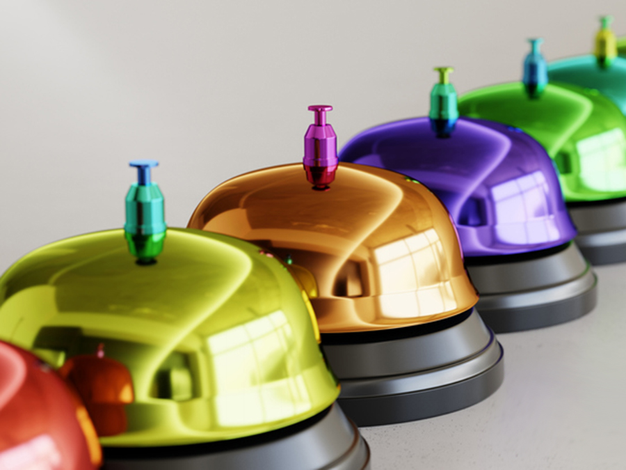 Line of vibrantly colored reception bells illustrate our custom nonprofit communications services.