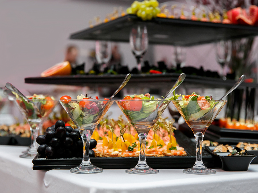 Beautifully decorated catering banquet table with canape, vegetables, and fruit illustrates special events
