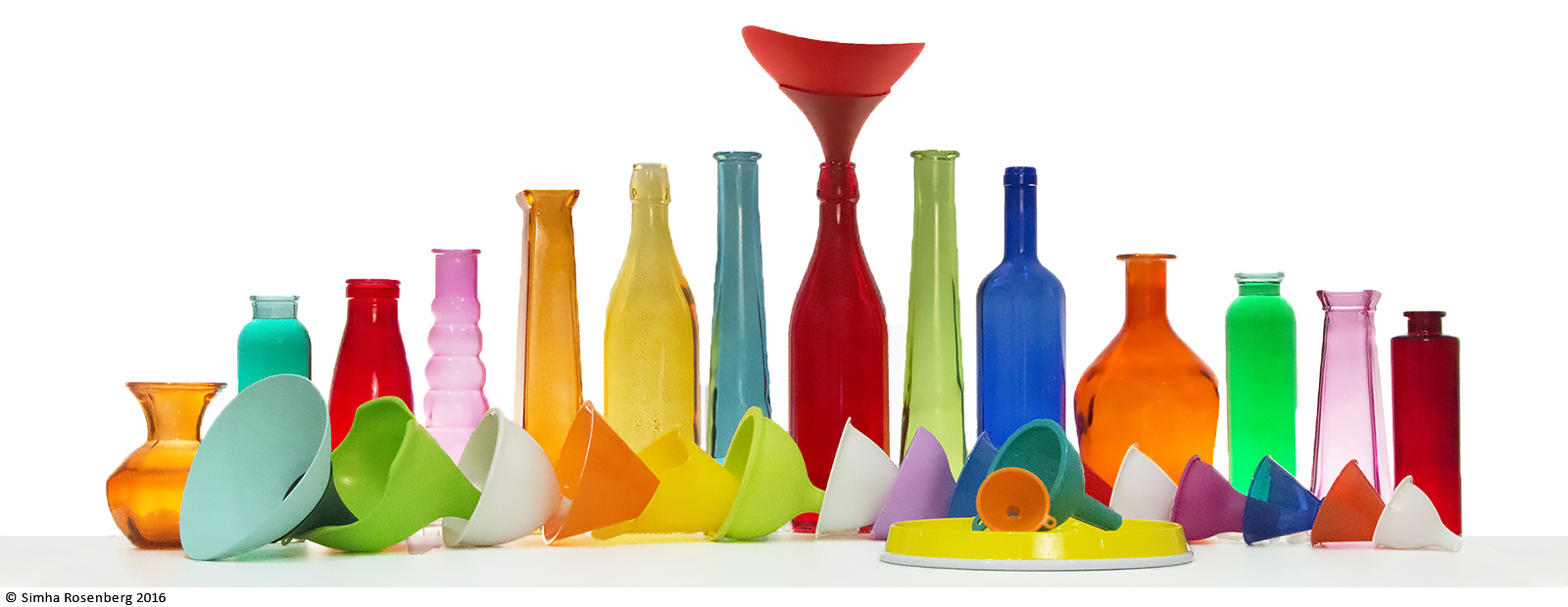 Colorful photo of bottles and funnels illustrates the concept that smart nonprofit marketing funnels in more support.